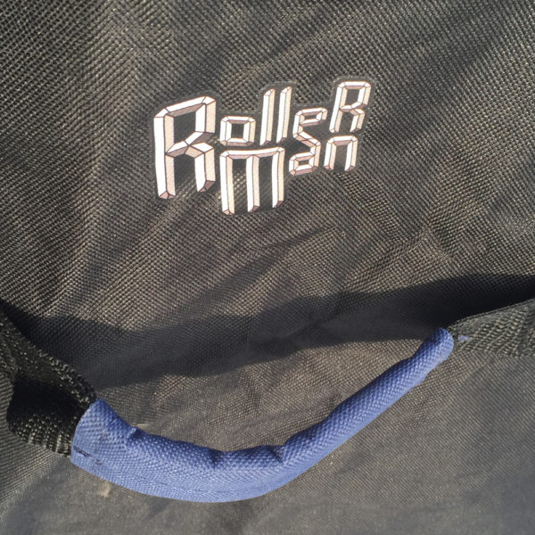 detail of the rollerman logo near the handle of big blue bag designed by Jean Yves Blondeau
