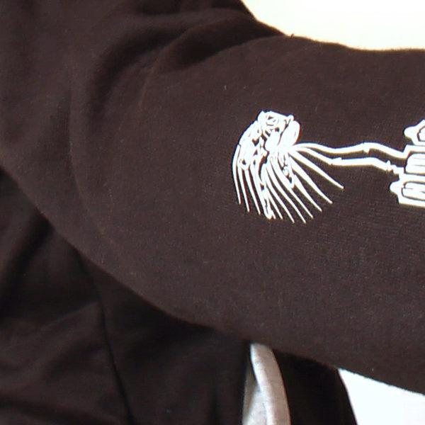 sleeve detail of scrape pilot on sleeve of buggy rollin team hoodie designed by Jean Yves Blondeau