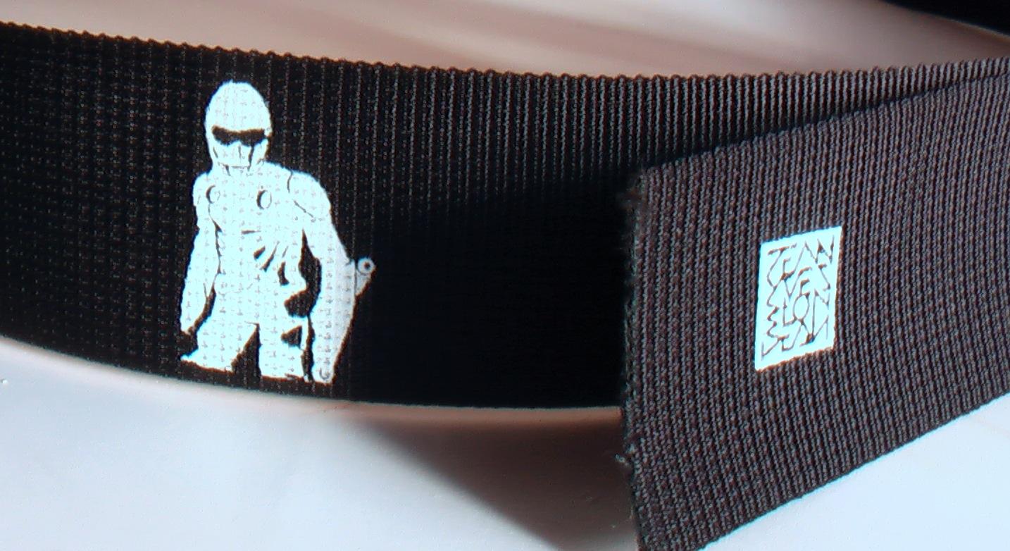 silhouette of rollerman printed on belt