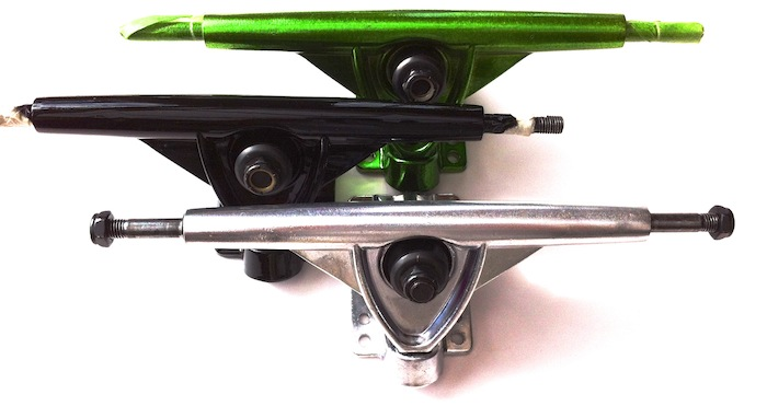 3 randall trucks of different colors. metal, green and black
